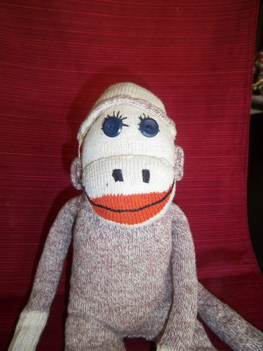 Vintage Sock Monkey Eyelashes and Hat Doll Handstitched Stuffed Animal.  He looks just like my Herbie but for the button eyes.  My monkey's eyes are hand stitched.  I got him in 1958 for Christmas, when I was 7.