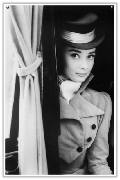 Real-life equestrienne Audrey Hepburn in a hunters top hat.