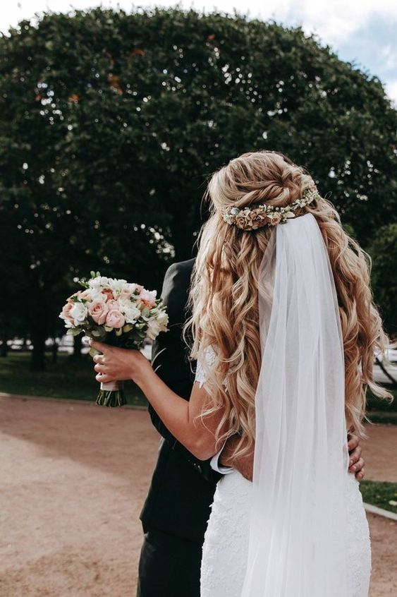 Big Voluminous Curls With Floral Piece And Bridal Veil On A Half Up Half Down Do Gorgeous Half Up Half Down B Wedding Hair Down Flowers In Hair Hair Styles