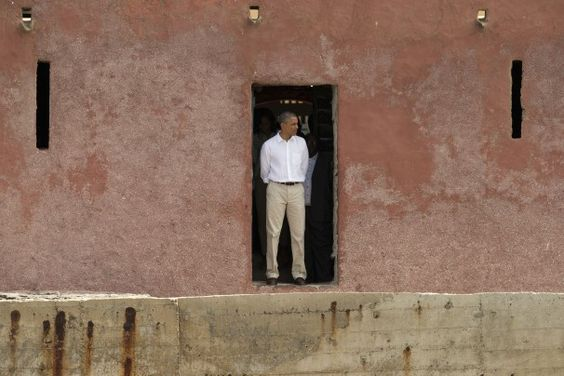 """Obama visits Senegal, stands at the """"Door of No Return, """" at the slave house on Goree Island off Dakar. He called his trip a """"very powerful moment."""" The Washington Post"""
