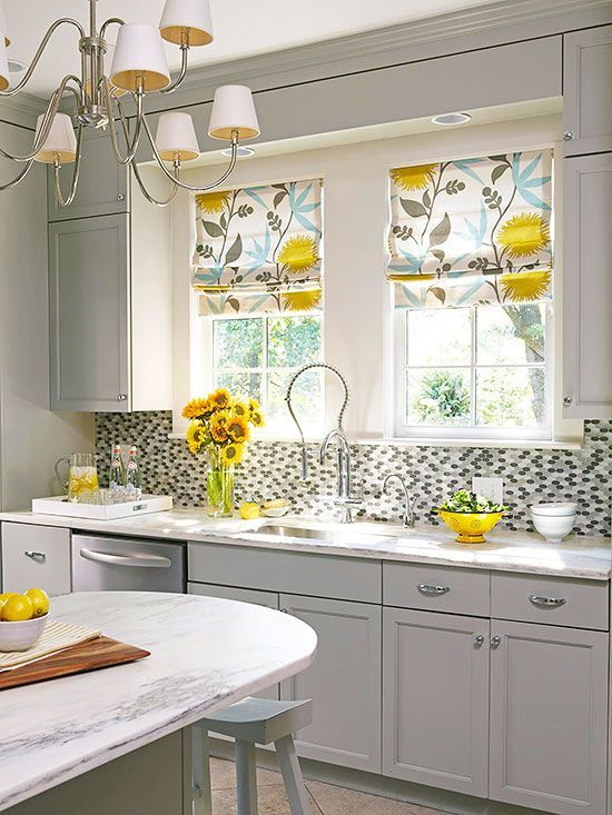 Add a pop of color and pattern to your windows with fun treatments. Keep in mind that complex window treatments, like Roman shades, need to be professionally cleaned, but cafe curtains and certain valances can be tossed in the wash to eliminate cooking smells and the inevitable kitchen splatters./