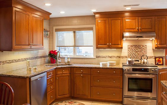 Corner sink cherry wood cabinets and stainless steel for Traditional kitchen appliances