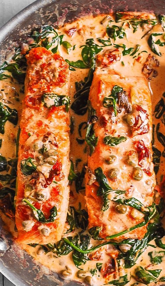 Creamy Tuscan Salmon with Garlic, Spinach, Artichokes, Sun-Dried Tomatoes, and Capers