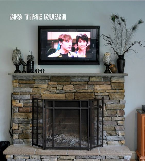 How To Decorate A Mantle With A Tv Above It A Tall Piece On One Side Of Tv Different Heights