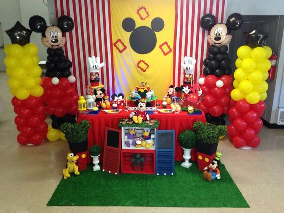 Dessert table and backdrop at a Mickey Mouse birthday party! See more party planning ideas at CatchMyParty.com!: