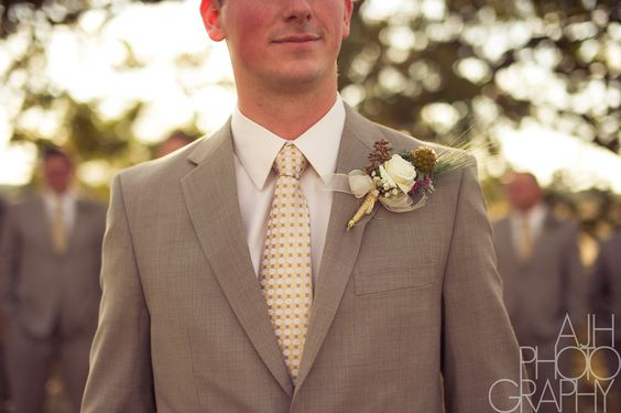 Love the material of the tux and the clever use of flowers!