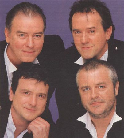 Four of the Bay City Rollers... my favorite band as a kid.  They grew up all right.