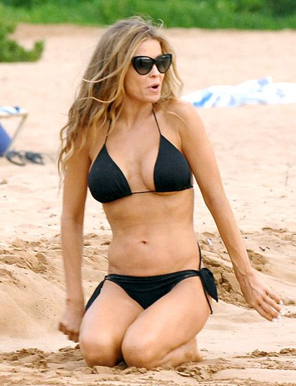 Carmen Electra Sizzling! The Baywatch alum, 41, looked hotter than ever in a black bikini while hanging out with friends in Hawaii in October 2013.