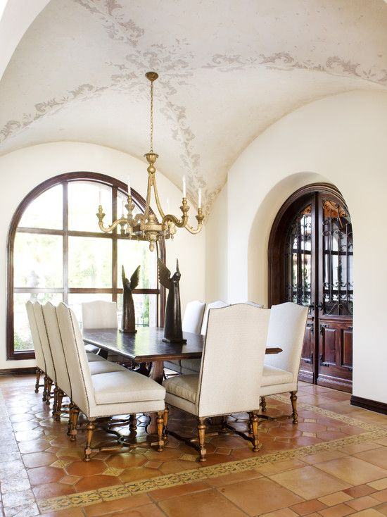 "I appreciate the look of the Mexican tiles in varying shapes, sizes, and colors as well as the beautiful decorative inlay which creates a tile ""area rug"" for the dining table.   The subtle groin vault in the ceiling is accented by delicate stenciling and I like the arched windows and doors. Lots of light but the space still projects the ""sturdiness"" of Mexican influenced spaces."