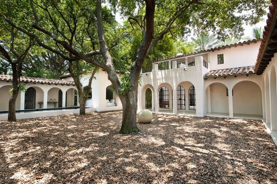 Calvin Klein antiques from Italy and Morocco—in tones as neutral as that of his apparel, Spanish-style arches, a balcony, a dome kitchen and has its own private courtyard. One of its most striking features is a private dock and infinity pool overlooking the Biscayne Bay. The 74-year-old originally listed the expansive home for $16M in 2015, after purchasing the beach pad 10 years ago.