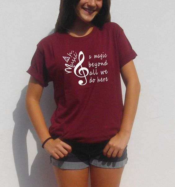 Welcome to FavoriTee! Harry potter unisex t-shirt. Ah, music. A magic beyond all we do here, Dumbledore quote. These shirts run a little big. The model