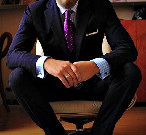 Navy suit, light blue gingham shirt, purple tie.