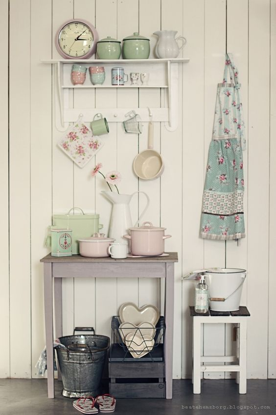 Team pastel and floral accents with cream walls to create a charming romantic kitchen display.