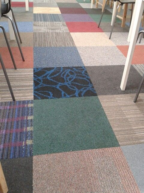 Fun use of random carpet tiles at Fidgets play centre in Bromley Cross, Bolton