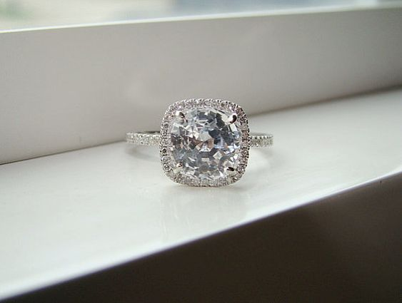 halo gemstones and engagement rings on