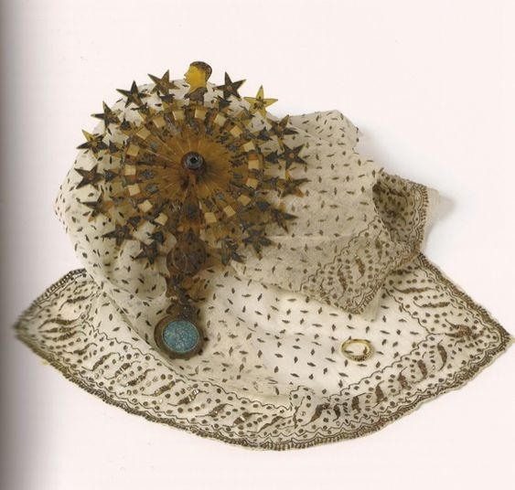 A fan and shawl belonging to Joséphine, displayed with a ring presented to her by Napoléon in 1796, the year that they were married after a whirlwind