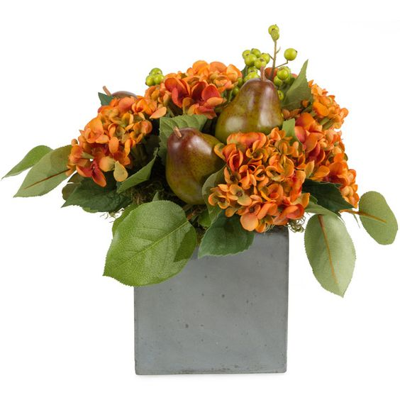 Faux hydrangea flowers pears salal leaves in cement cube