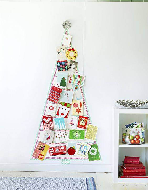 This DIY washi tape tree is a no-fuss way to display the holiday cards that arrive in your mailbox each day! It comes right off the wall when you're done.: