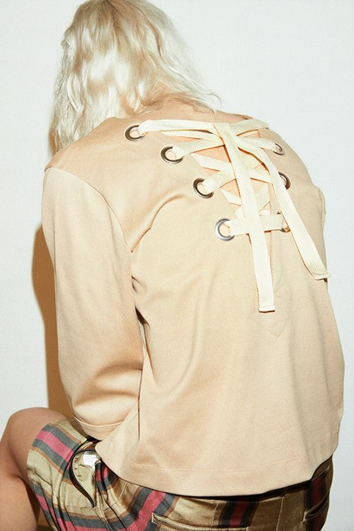 back details with oversized eyelets.
