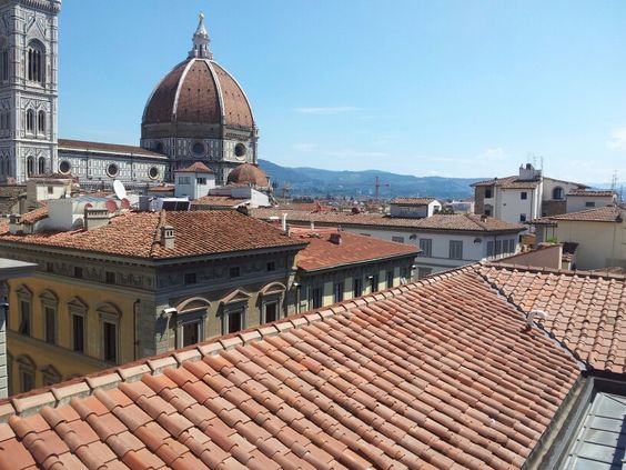 Sippjng a cappucino at a rooftop cafeteria , whilst admiring the Florentine skyline...