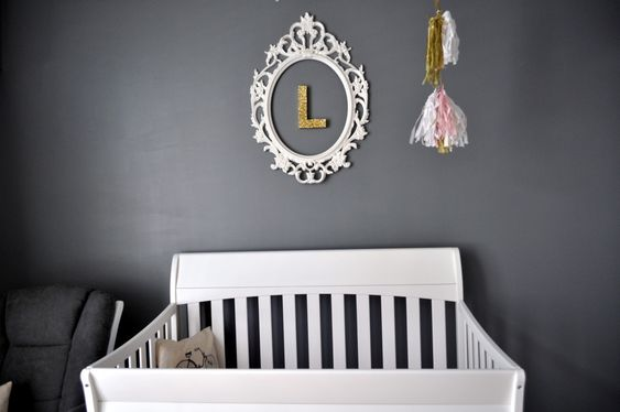 Love these dark gray walls with the framed metallic baby initial! #nursery