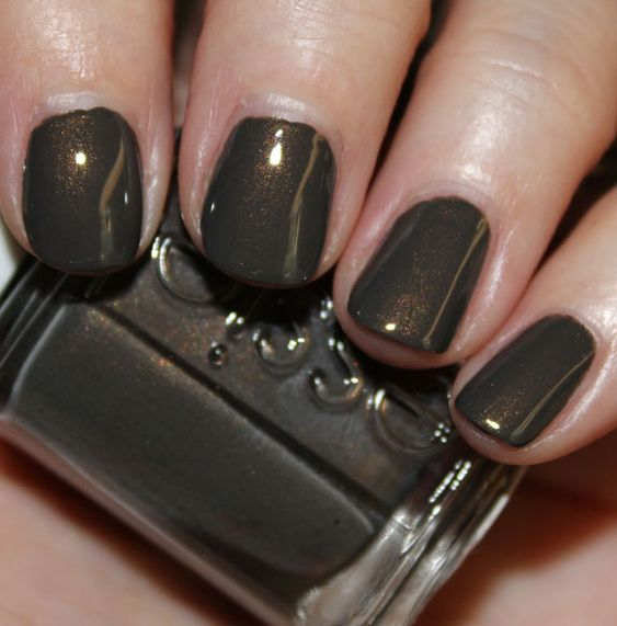Vampy Varnish swatch of Essie Armed & Ready for Spring 2012. dark olive green grey brown with olive shimmer. Gorgeous!