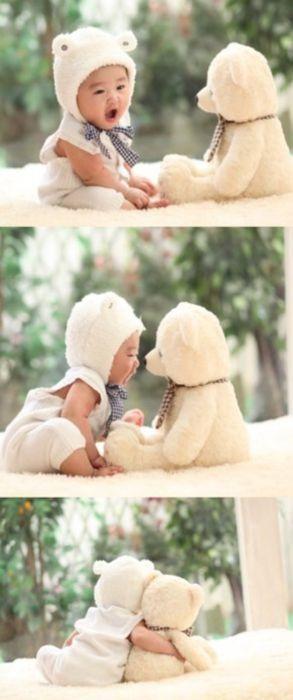 toddler in bear costume + stuffed teddy bear = best friends