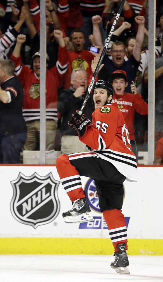 Chicago Blackhawks center Andrew Shaw (65) celebrates after scoring the winning goal during the third overtime period of Game 1 in their NHL Stanley Cup...