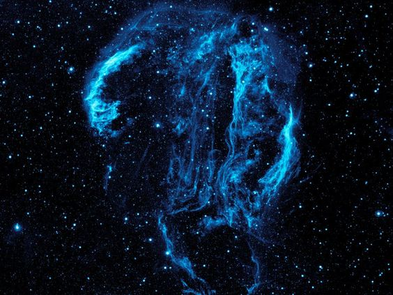 A lovely shot of the Veil nebula, an old supernova remnant, as seen by GALEX, a NASA mission designed to look at galaxies in the ultraviolet. See here: http://www.nasa.gov/mission_pages/galex/pia15415.html