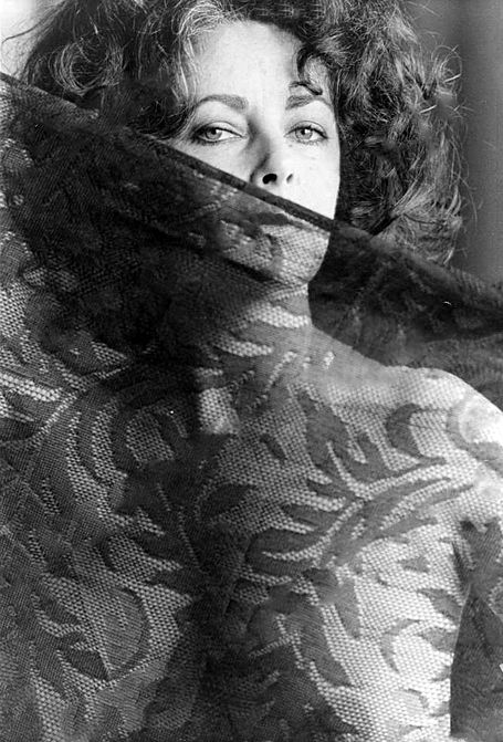 I always thought that Elizabeth Taylor was so sensuous. Here she poses nude behind a sheer veil.: