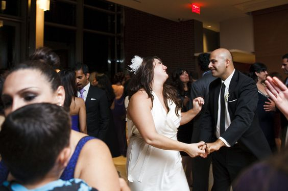 Enjoying the moment at a Wedding at the Royal Conservatory of Music in Toronto.  Photo by Boyfriend / Girlfriend.