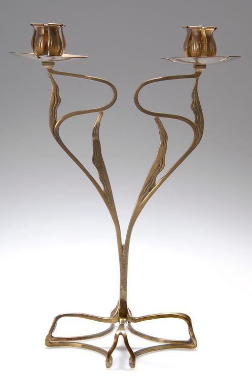 FRANZ RINGER Floriform brass candelabra, c. 1908, manufactured by the United Workshops for Handcrafted Art, Munich, 31.8cm H.   SOLD $4,230 Germany 2007