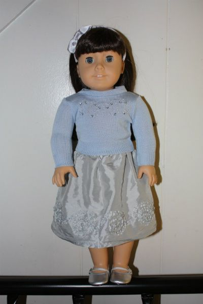 This outfit, while not explicitly marketed as a Hanukkah outfit, does appear in the catalogue and in store displays with the Hanukkah accessories.  It includes:    silver skirt  blue sweater  silver