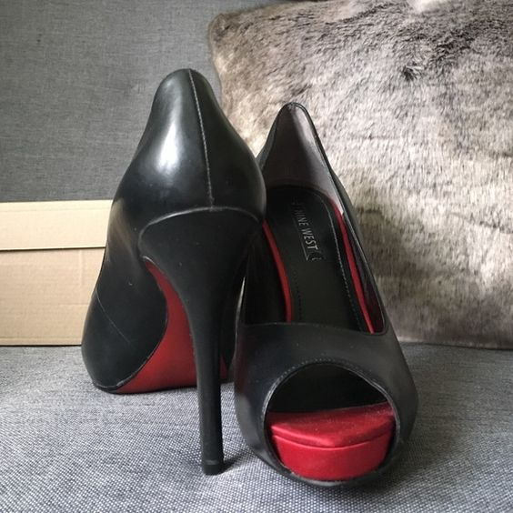NineWest Red Bottom peep toe leather heels size8.5 Gently worn (see photos) NineWest Black leather upper peep toe pumps! Super sexy red bottoms. Nine West Shoes Heels