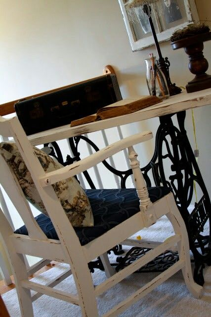 Old sewing machine stand turned table