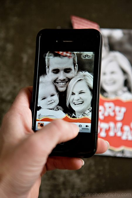 take a picture of christmas cards you get to use as contact pics.  love this idea.