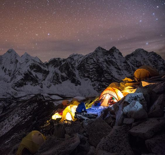 Photo- @andy_bardon /// A group of climbers melt snow for drinking water at 19000ft the night before their climb on #AmaDablam . by natgeo