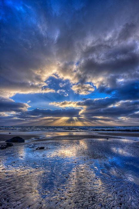 Stormy blue sunset in Morro Bay, California, United States.