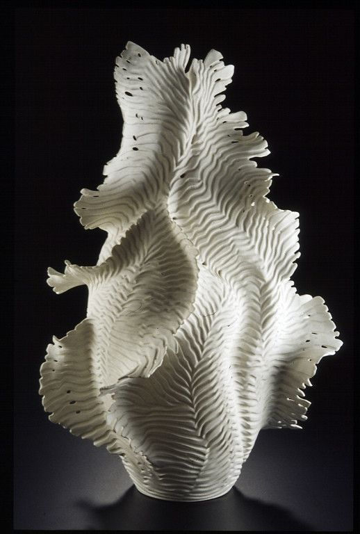 """Sculptural Porcelain Archives - Debra Steidel. """"Ocean Lace"""" This piece was about 26"""" tall when it went into the kiln, about an inch shy of the top. It was thrown in 2 pieces, altered and then coils of clay added to the sides and pulled out into wings. When it was leather hard, I carved the groves and edges and pierced the holes. It was fired to cone 10 with no glaze."""
