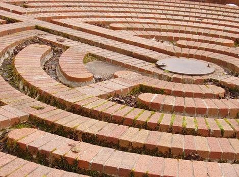 This water maze is beautiful when filled with rainwater. It is distinctive because it is a Chartres Maze. This special type of maze is based upon Christian mythology.