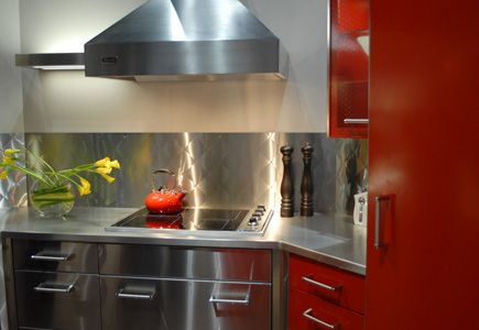 Stainless steel cabinets in metallic and red finishes.