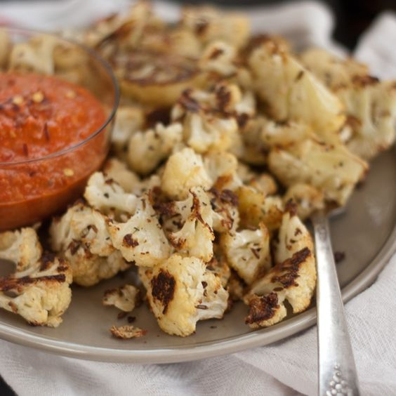 <p>Here's a great recipe for cumin-roasted cauliflower with a side of roasted red pepper pesto. It's a perfect pairing for those who like bold, spicy food.</p>