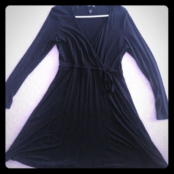 Black wrap dress with tie waist Great condition. I usually wear size 6-8 and this fits perfect with some give H&M Dresses