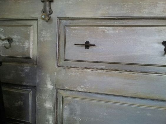 Old distressed door with antique hooks for a great coat hanger in the entry.