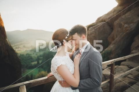 Young Newly Wed Couple Bride And Groom Kissing Hugging On Perfect View Of Premium Photo 75960339 Wedding Couples Wedding Kiss Newlyweds