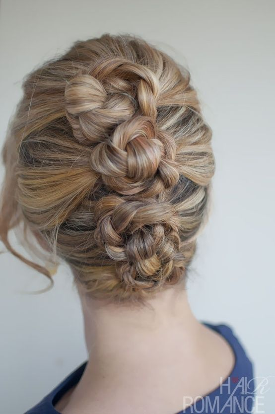 Make three ponytails, braid, then twist into three buns and pin. Lovely!  **When I try this it'll probably look like a weed wacker got stuck in my hair, but I love it.**