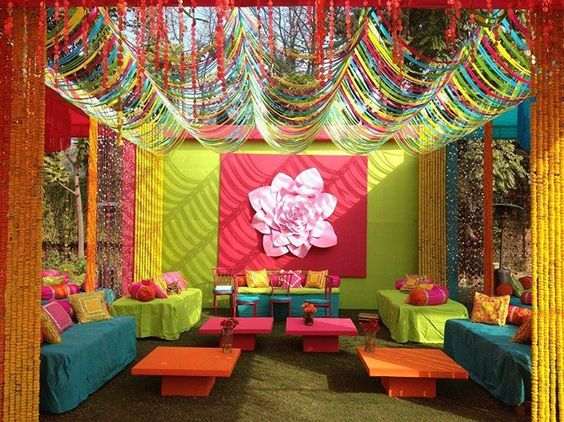 Funky mehndi ceremony decor idea paperwork for Sangeet decorations at home