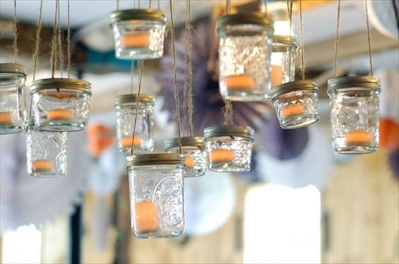 Mason jar lanterns  Put two holes in the top of the lid and poke through some twine. I'd hang them from tree branches :)