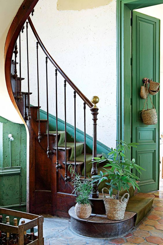 Vintage wood curving #staircase in a renovated 12th-century chateau. From the January 2016 issue of Inside Out magazine. Photography by Yann Deret/Basset Images.