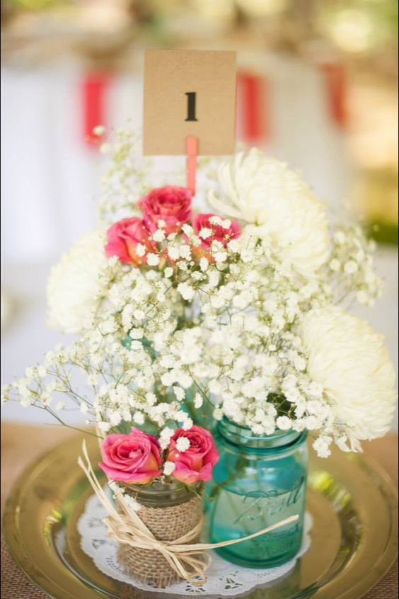 Baby's Breath, Spray Roses, and Football Mums go perfectly with the burlap details and mason jars.